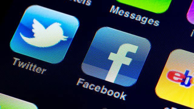 Facebook Twitter apps on mobile phone_2316745450965825-159532