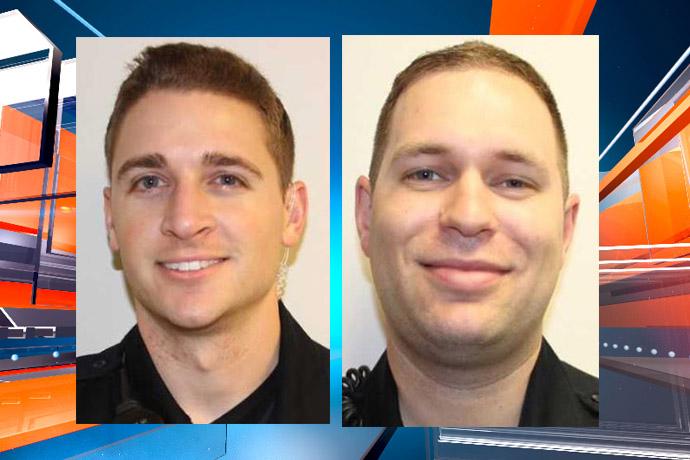 mattoon pd officers luke wilson & tyler poland_1529684196200.jpg.jpg